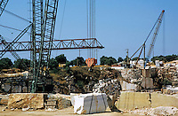 Cranes at a marble quarry storage site, Estremoz, Portugal.