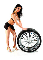 AJ ALEXANDER/APA - Product-Tire Rims with Model Melyssa Herrera<br />