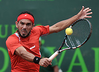 BOGOTA - COLOMBIA -10 -11-2013: Victor Estrella, tenista de Republica Dominicana, devuelve la bola a Thomaz Bellucci, tenista de Brasil, durante partido de la final del Seguros Bolivar Open en el Club Campestre el Rancho de la ciudad de Bogota. / Victor Estrella, Republica Dominicana,  tennis player returns the ball to Thomaz Bellucci, Brazil tennis player during a match for the finals of the Seguros Bolivar Open in the Club Campestre El Rancho in Bogota city. Photo: VizzorImage  / Luis Ramirez / Staff.