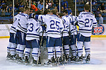 February 20, 2016 - Colorado Springs, Colorado, U.S. -   Air Force Falcons huddle prior to an NCAA ice hockey game between the Robert Morris University Colonials and the Air Force Academy Falcons at Cadet Ice Arena, United States Air Force Academy, Colorado Springs, Colorado.  Air Force defeats Robert Morris 4-1