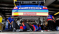 Aug. 8, 2009; Watkins Glen, NY, USA; Crew members work on the rear end of the car driven by NASCAR Sprint Cup Series driver Max Papis during practice for the Heluva Good at the Glen. Mandatory Credit: Mark J. Rebilas-