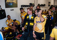 Prince Harry mingles with the Hurricanes team in the Hurricanes changing rooms after the Super Rugby match between the Hurricanes and Sharks at Westpac Stadium, Wellington, New Zealand on Saturday, 9 May 2015. Photo: Dave Lintott / lintottphoto.co.nz