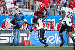Kelvin Harmon (3) of the North Carolina State Wolfpack catches a pass over the top of JaMarcus King (7) during first half action in the Belk College Kickoff at Bank of America Stadium on September 2, 2017 in Charlotte, North Carolina.  The Gamecocks defeated the Wolfpack 35-28.  (Brian Westerholt/Four Seam Images)