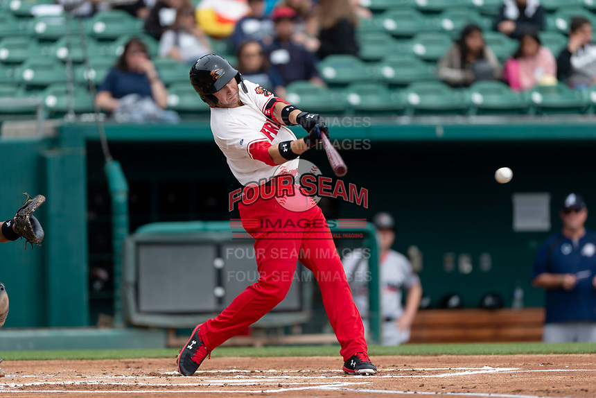 Fresno Grizzlies shortstop Carter Kieboom (8) swings at a pitch during a game against the Reno Aces at Chukchansi Park on April 8, 2019 in Fresno, California. Fresno defeated Reno 7-6. (Zachary Lucy/Four Seam Images)