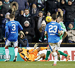 Wes Foderingham dives in to block Anthony Stokes