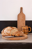 A sliced freshly-made loaf of bread awaits hungry pilgrims in the kitchen