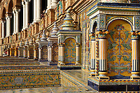 Detail of tiled niches, Plaza de Espana, Seville, Spain, pictured on January 4, 2007, in the morning. Built in the Maria Luisa Park for the  Ibero-American Exposition of 1929, this huge semi-circular building, designed by Anibal Gonzalez, is a good example of Sevillian Regionalism, a combination of  Neo-Mudejar and Art Deco styles. There is a tower at each end, and a fountain in the centre of the semi-circle. Picture by Manuel Cohen.