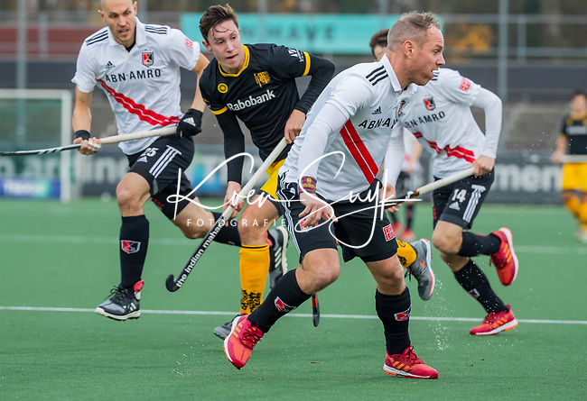 AMSTELVEEN -  Teun Rohof (Adam) tijdens de competitie hoofdklasse hockeywedstrijd mannen, Amsterdam- Den Bosch (2-3).  COPYRIGHT KOEN SUYK