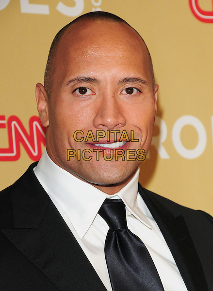 """DWAYNE """"THE ROCK"""" JOHNSON.at The 3rd Annual CNN Heroes: An All-Star Tribute held at The Kodak Theatre in Hollywood, California, USA,  November 21st 2009                                                                   .portrait headshot grey gray black suit tie white shirt eye contact smiling .CAP/RKE/DVS.©DVS/RockinExposures/Capital Pictures"""