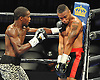 Titus Williams, an Elmont native, left, lands a left cross against opponent Micah Branch during a Premier Boxing Champions match at the Barclays Center on Saturday, August 1, 2015. Williams, making his professional debut, won the four-round bout by unanimous decision. <br /> <br /> James Escher
