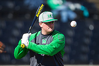 Marshall Thundering Herd head coach Jeff Waggoner hits fungos prior to the game against the Georgetown Hoyas at Wake Forest Baseball Park on February 15, 2014 in Winston-Salem, North Carolina.  The Thundering Herd defeated the Hoyas 5-1.  (Brian Westerholt/Four Seam Images)