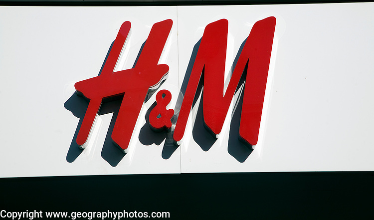 Close up of red letters of H&M shop, an example high street chain store brand