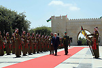 Palestinian President Mahmoud Abbas reviews the Jordanian honor guards during his visiting in Amman, Jordan on Aug. 08, 2018. Photo by Thaer Ganaim