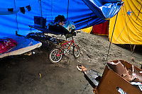 A temporary tent, the home of circus performers at the Circo Anny, a family run circus wandering the Amazon region of Ecuador, 4 July 2010. The Circo Anny circus belongs to the old-fashioned traveling circuses with a usual mixture of acrobat, clown and comic acts. Due to the general loss of popularity caused by modern forms of entertainment such as movies, TV shows or internet, these small family enterprises balance on the edge of survival. Circuses were pushed away and now they have to set up their shows in more remote villages. The circus art and culture is slowly dying.