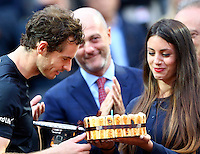 L'inglese Andy Murray soffia su una torta preparata in occasione del suo compleanno mentre tiene il trofeo dopo aver vinto la finale maschile degli Internazionali d'Italia di tennis a Roma, 15 maggio 2016.<br /> Britain's Andy Murray blows on a cake prepared on the occasion of fish birthday as he holds the trophy after winning the men's final match of the Italian Open tennis against Serbia's Novak Djokovic in Rome, 15 May 2016.<br /> UPDATE IMAGES PRESS/Riccardo De Luca
