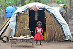 A three-year old girl in a camp for more than 5,000 displaced people in Riimenze, in South Sudan's Gbudwe State, what was formerly Western Equatoria. Families here were displaced at the beginning of 2017, as fighting between government soldiers and rebels escalated.<br /> <br /> Two Catholic groups, Caritas Austria and Solidarity with South Sudan, have played key roles in assuring that the displaced families here have food, shelter and water.