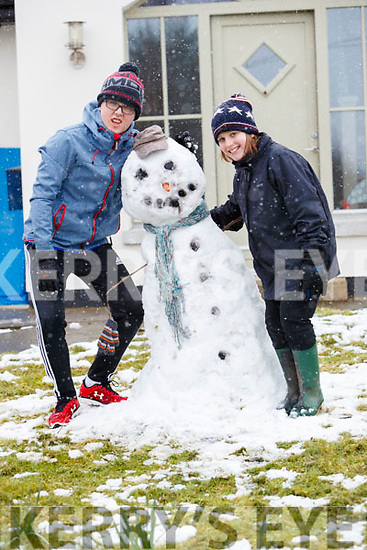 Hugh and Robert Emerson with their snowman in Ballyard on Friday.