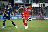 Cary, NC - Saturday April 22, 2017: Portland's Christine Sinclair (12) is defended by Carolina's Abby Erceg (6) during a regular season National Women's Soccer League (NWSL) match between the North Carolina Courage and the Portland Thorns FC at Sahlen's Stadium at WakeMed Soccer Park.