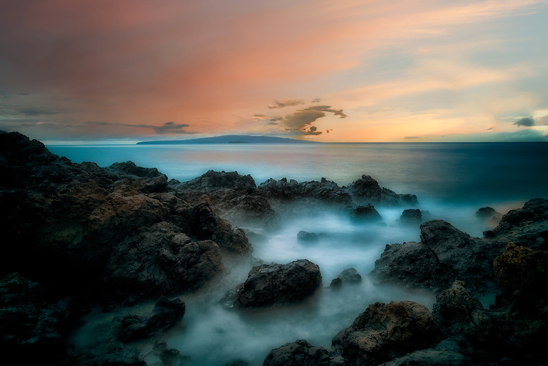 Sunset and rocky coastline. Maui, Hawaii
