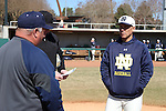 CARY, NC - MARCH 05: Notre Dame head coach Mik Aoki (right) with Monmouth head coach Dean Ehehalt (left). The Monmouth University Hawks played the University of Notre Dame Fighting Irish on March 5, 2017, at USA Baseball NTC Field 2 in Cary, NC in a Division I College Baseball game, and part of the Irish Classic tournament. Notre Dame won the game 4-0.