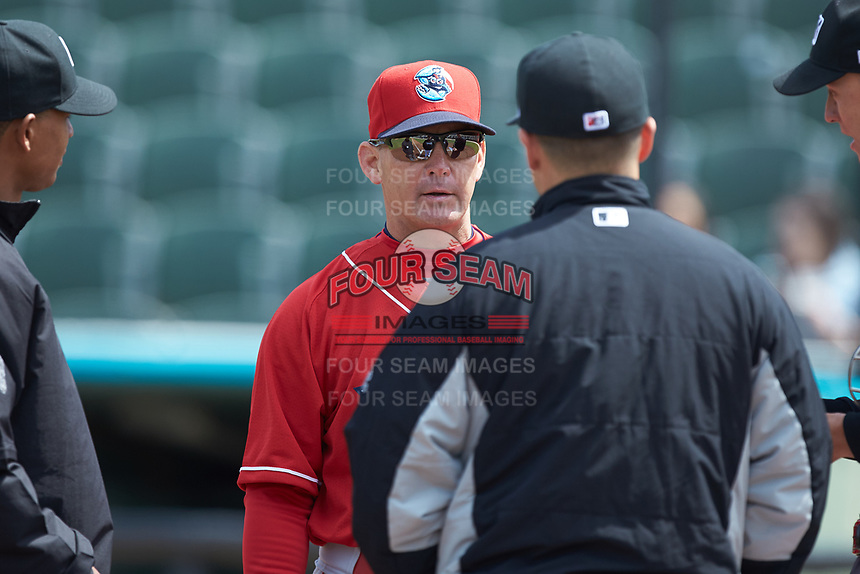Lakewood BlueClaws manager Marty Malloy (2) meets with Kannapolis Intimidators manager Justin Jirschele (9) prior to their game at Kannapolis Intimidators Stadium on April 8, 2018 in Kannapolis, North Carolina.  The Intimidators defeated the BlueClaws 5-1 in game one of a double-header.  (Brian Westerholt/Four Seam Images)