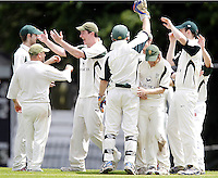 North London players celebrate after capturing the wicket of Mitchell Fry during the Middlesex County Cricket League Division Three game between Wembley and North London at Vale Farm, Wembley on Sat May 31, 2014