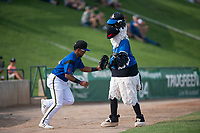 Missoula Osprey second baseman Eddie Hernandez (10) gets a high five Ollie Osprey before a Pioneer League game against the Orem Owlz at Ogren Park Allegiance Field on August 19, 2018 in Missoula, Montana. The Missoula Osprey defeated the Orem Owlz by a score of 8-0. (Zachary Lucy/Four Seam Images)