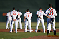 General view of Baltimore Orioles pitcher Ubaldo Jimenez (31) during the national anthem before a Spring Training game against the Atlanta Braves on April 3, 2015 at Ed Smith Stadium in Sarasota, Florida.  Baltimore defeated Atlanta 3-2.  (Mike Janes/Four Seam Images)