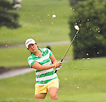 Christine Song from Fullerton, California punched the ball out of the bunker on the 8th hole at Alliance Bank Golf Classic in Syrcause, NY.