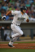 Designated hitter Tim Tebow (15) of the Columbia Fireflies runs toward first base in a game against the Lexington Legends on Saturday, April 22, 2017, at Spirit Communications Park in Columbia, South Carolina. Lexington won, 4-0. (Tom Priddy/Four Seam Images)