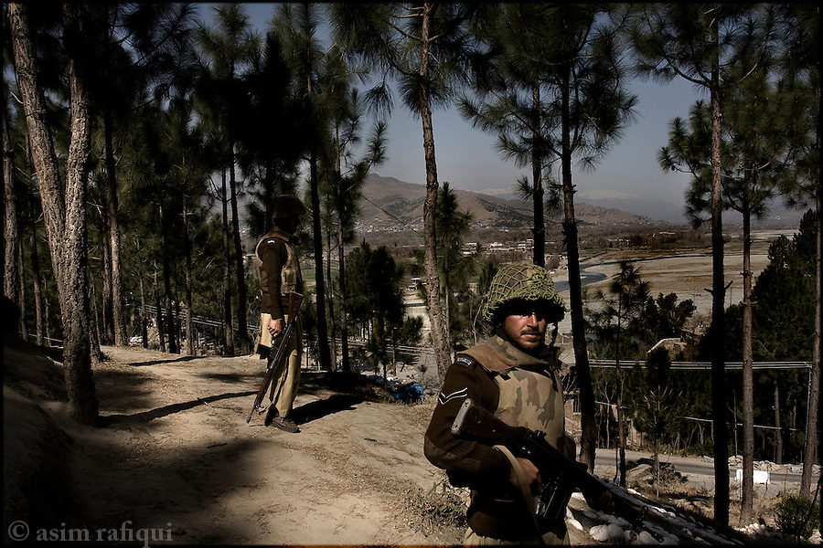 pakistan army soldiers on patrol in the foothills of the mountains around the town of mingora, swat.  the army is fighting self-proclaimed islamic militants who have carried out a number of bombing attacks against government and civilian targets in the region