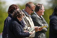 Former Premier League referee, Graham Poll (centre), looks at the mat day programme during the Bedfordshire County Football League match between Ampthill Town U18 and Renhold United Reserves at Shefford Sports Club, Shefford, England on 30 April 2016. Photo by David HornPRiME Media Images.