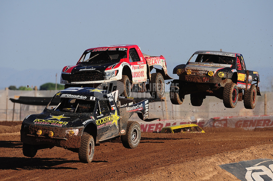 Apr 17, 2011; Surprise, AZ USA; LOORRS driver Rob MacCachren (1) leads Rodrigo Ampudia (36) and Greg Adler (10) during round 4 at Speedworld Off Road Park. Mandatory Credit: Mark J. Rebilas-
