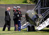 United States President George W. Bush and first lady Laura Bush board Marine One following the funeral service for former White House press secretary Tony Snow at the Catholic University in Washington on July 17, 2008. Snow died on July 12, at the age of 53, following a battle with colon cancer. <br /> Credit: Kevin Dietsch / Pool via CNP