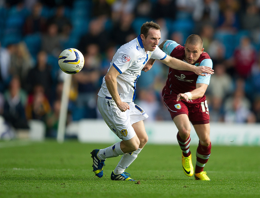 Burnley's Michael Kightly attempts to get past Leeds United's Aidan White<br /> <br /> Photo by Stephen White/CameraSport<br /> <br /> Football - The Football League Sky Bet Championship - Leeds United v Burnley - Saturday 21st September 2013 - Elland Road - Leeds<br /> <br /> &copy; CameraSport - 43 Linden Ave. Countesthorpe. Leicester. England. LE8 5PG - Tel: +44 (0) 116 277 4147 - admin@camerasport.com - www.camerasport.com
