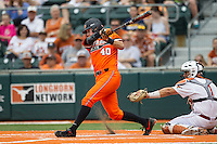 Oklahoma State Cowboys third baseman Craig McConaughy #40 swings the bat during the NCAA baseball game against the Texas Longhorns on April 26, 2014 at UFCU Disch–Falk Field in Austin, Texas. The Cowboys defeated the Longhorns 2-1. (Andrew Woolley/Four Seam Images)