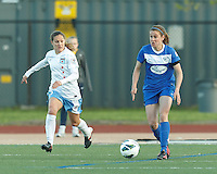 Boston Breakers midfielder Heather O'Reilly (9) looks to pass as Chicago Red Stars defender Lydia Vandenbergh (13) closes. In a National Women's Soccer League Elite (NWSL) match, the Boston Breakers (blue) defeated Chicago Red Stars (white), 4-1, at Dilboy Stadium on May 4, 2013.