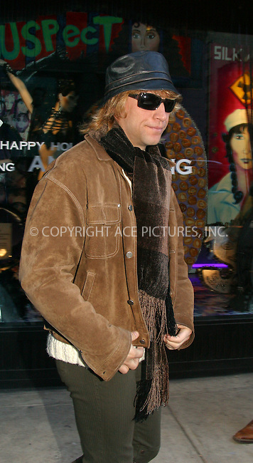 Jon Bon Jovi seen last minute Christmas shopping on Madison Avenue in New York. He checked out some shoulder bags at Barney's New York and was particularly interested in a white fur coat at Roberto Cavalli store. New York, December 23, 2002. Please byline: Alecsey Boldeskul/NY Photo Press.   ..*PAY-PER-USE*      ....NY Photo Press:  ..phone (646) 267-6913;   ..e-mail: info@nyphotopress.com