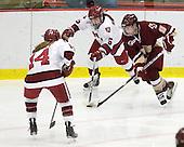 Jillian Dempsey (Harvard - 14), Kelsey Romatoski (Harvard - 5), Allie Thunstrom (BC - 9) - The Harvard University Crimson defeated the Boston College Eagles 5-0 in their Beanpot semi-final game on Tuesday, February 2, 2010 at the Bright Hockey Center in Cambridge, Massachusetts.
