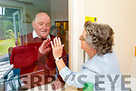 Catherine Dunne from Tralee during her first visit in 12 weeks to her brother Martin Cournane in Cúil Dídin Nursing home on Saturday.