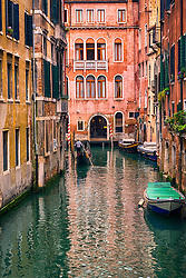 A gondola passing through a small canal of the Canal Grande, Venice.