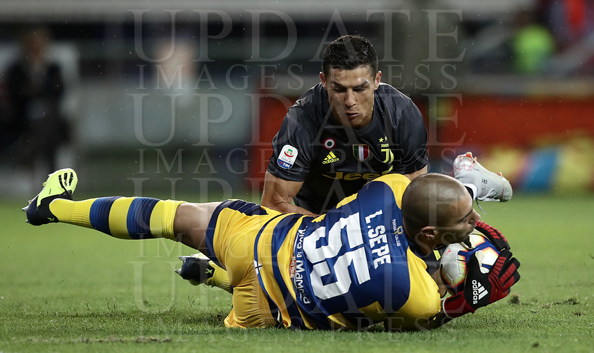 Calcio, Serie A: Parma - Juventus, Parma stadio Ennio Tardini, 1 settembre 2018.<br /> Juventus' Cristiano Ronaldo (top) in action with Parma's goalkeeper Luigi Sepe (bottom) during the Italian Serie A football match between Parma and Juventus at Parma's Ennio Tardini stadium, September 1, 2018. <br /> UPDATE IMAGES PRESS/Isabella Bonotto
