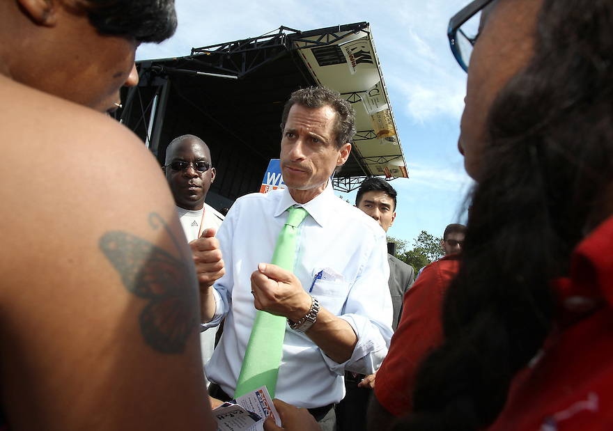 Mayoral candidate Anthony Weiner speaks to voters while making a campaign stop at Roy Wilkins Park on Saturday, Sept. 7, 2013 Queens, New York. (AP Photo/ Donald Traill)