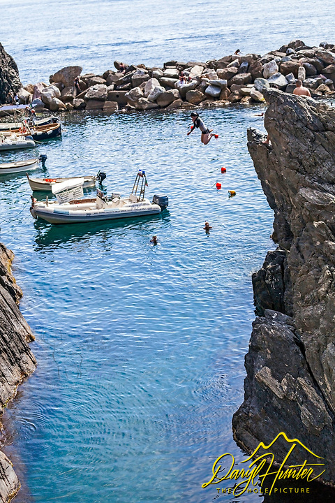 Cliff jumper, Manarola harbor, Cinque Terre Italy.