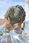 Welder at work on roof<br />