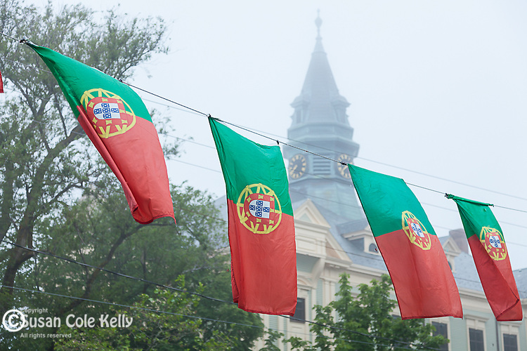 Brightly colored flags celebrate the Portugese Festival in Provincetown, Cape Cod, Massachusetts, USA