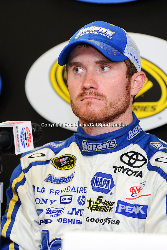 July 14, 2013 - Loudon, New Hampshire U.S. - Sprint Cup Series driver Brian Vickers (55) answers questions from the press after winning the NASCAR Sprint Cup Series Camping World RV Sales 301 held at the New Hampshire Motor Speedway in Loudon, New Hampshire.   Eric Canha/CSM