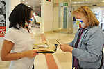 Employees distribute sanitary kits to first visitors in the Xanadu Shopping Center in Madrid on the day of its reopening during the beginning of Phase 2 of the unconfinement during the health crisis due to the Covid-19 - Coronavirus pandemic. June 8,2020. (ALTERPHOTOS/Ricardo Blanco)