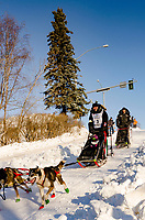 Otto Balogh and team run past spectators and down the Cordova Street hill with an Iditarider in the<br /> basket and a handler during the Anchorage, Alaska ceremonial start on Saturday March 4th<br /> during the 2017 Iditarod race. Photo  @2017 by Kristie Lent/ SchultzPhoto.com