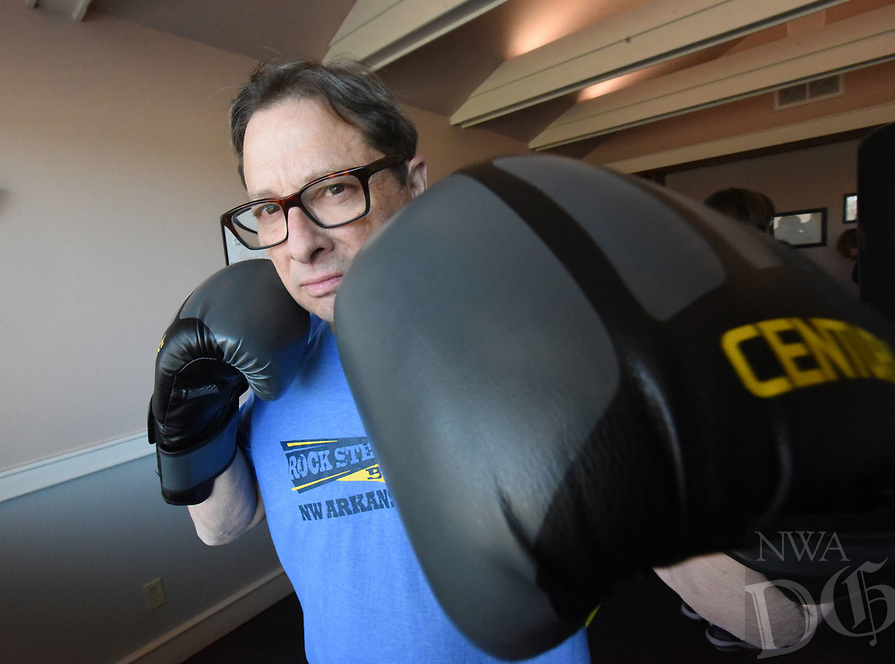 NWA Democrat-Gazette/FLIP PUTTHOFF <br /> Craig Campbell warms up Dec. 5 2018 for a Rock Steady Boxing workout in Rogers.
